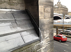 leadwork on sloping roof of St Pauls Edinburgh with Balmoral in background