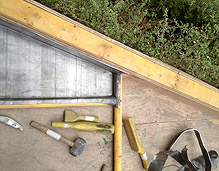 complete section of roof and roofers tools